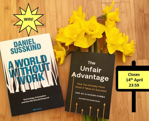Two books lying on a wooden floor. Daniel Susskind's A World Without Work and The Unfair Advantage by Ash Ali and Hasan Kuba. There is also a bunch of daffodils. There are two signs, one saying Win! and one saying closes 14th April 23:59.